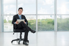 Businessman with folders Royalty Free Stock Photography