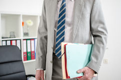 Businessman with folders under his arm Royalty Free Stock Images