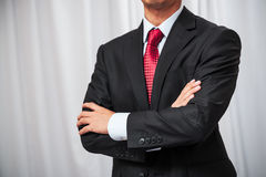 Businessman folding his arms Royalty Free Stock Image