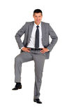 Businessman with a foot on a step Royalty Free Stock Photos