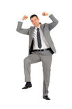 Businessman with a foot on a step Stock Photo