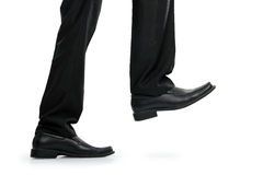 Businessman foot stepping Stock Photos