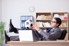 The businessman with football ball in office Royalty Free Stock Images