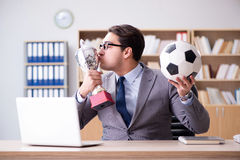 The businessman with football ball in office Stock Photo