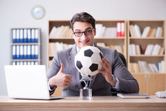 The businessman with football ball in office Royalty Free Stock Image