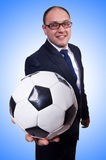 Businessman with football Royalty Free Stock Photo