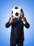 Businessman with football on the white Royalty Free Stock Photography
