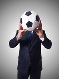 Businessman with football on white Royalty Free Stock Photography