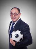 Businessman with football on white Royalty Free Stock Image