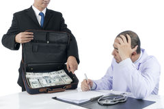 Businessman forced Doctor sign unfair contracts being offered a large sum of money Stock Images