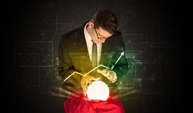 Businessman forecast the future of the stock market with a magic ball stock photography