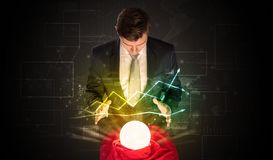 Businessman forecast the future of the stock market with a magic ball royalty free stock images