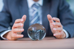 Businessman forecasting a crystal ball Stock Image
