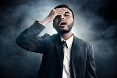 Businessman forgetful on smoke background Stock Photos