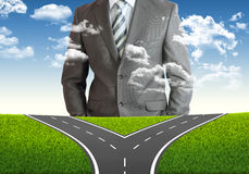 Businessman and fork in the road Stock Photo