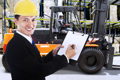 Businessman with forklift in a warehouse Royalty Free Stock Photography