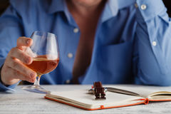 Businessman in formal dress relax with glass of cognac Stock Image