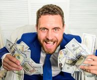 Businessman formal suit hold cash dollars hands. Che k out my profit this month. Earn money easy business tips. Man. Cheerful happy businessman with pile dollar stock images
