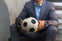 Man in a suit with a soccer ball royalty free stock images