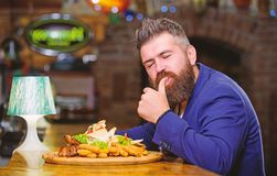 Businessman formal suit sit at restaurant. Man received meal with fried potato fish sticks meat. He deserve delicious. Meal. Enjoy your meal. High calorie snack stock photo