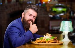 Businessman formal suit sit at restaurant. Man received meal with fried potato fish sticks meat. He deserve delicious. Meal. Enjoy your meal. High calorie snack royalty free stock photo