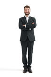 Businessman in formal wear with folded hands. Full-length portrait of smiley businessman in formal wear with folded hands looking at camera. isolated on white Stock Image