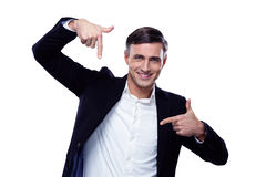 Businessman in formalwear gesturing finger frame. Over white background Royalty Free Stock Photo