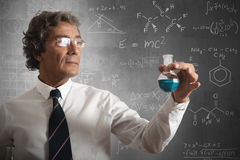 Businessman and formula for the success Stock Images