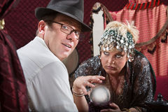 Businessman with Fortune Teller Royalty Free Stock Photos