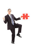 Businessman found the missing piece of a puzzle Royalty Free Stock Photo