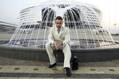 Businessman at fountain Stock Images
