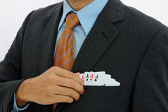 Businessman with four ace cards Royalty Free Stock Photos