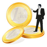 Businessman with four  big Euro coins. Businessman pointing at four  big Euro coins Royalty Free Stock Images