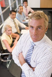 Businessman with four buinesspeople Royalty Free Stock Image