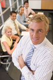 Businessman with four businesspeople Royalty Free Stock Images
