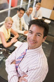Businessman with four businesspeople Stock Image