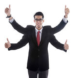 Businessman with four hands showing thumbs up Royalty Free Stock Photography