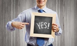 Businessman with frame Stock Photo
