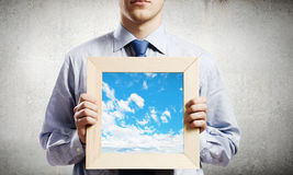 Businessman with frame Royalty Free Stock Photos