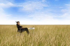 Businessman with the freedom of working anywhere Stock Image
