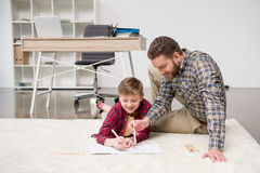 Businessman freelancer drawing with son Stock Photography