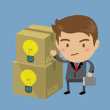 Businessman with fresh idea bulb in a box Stock Photos