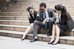 Businessman and friends with suit sitting at stair in city royalty free stock photo
