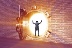 The businessman in front of banking vault door. Businessman in front of banking vault door Stock Photo
