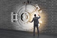 The businessman in front of banking vault door. Businessman in front of banking vault door Royalty Free Stock Image