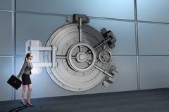 The businessman in front of banking vault door. Businessman in front of banking vault door Royalty Free Stock Photo