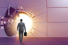 The businessman in front of banking vault door. Businessman in front of banking vault door Stock Photography