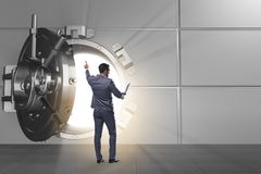The businessman in front of banking vault door. Businessman in front of banking vault door Stock Images