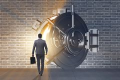 The businessman in front of banking vault door. Businessman in front of banking vault door Royalty Free Stock Photography