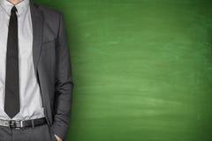Businessman front of Blackboard Stock Photos